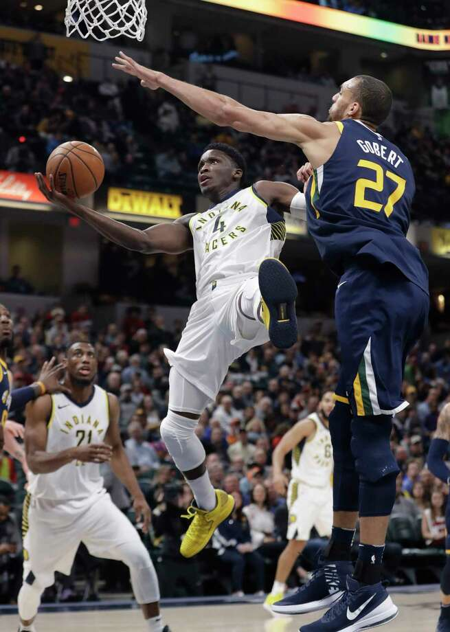 Indiana Pacers' Victor Oladipo is fouled by Utah Jazz's Rudy Gobert during the first half of an NBA basketball game Wednesday, March 7, 2018, in Indianapolis. (AP Photo/Darron Cummings) Photo: Darron Cummings / Copyright 2018 The Associated Press. All rights reserved.