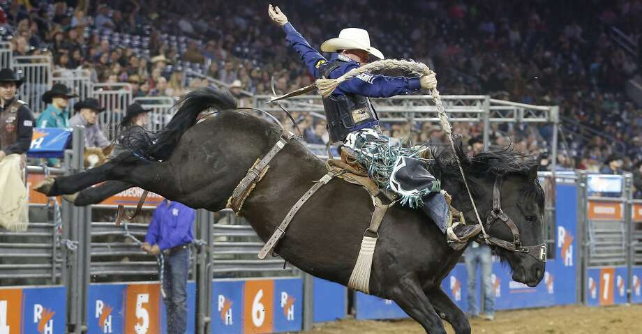 Jacobs Crawley rides Mtn Climber   during Super Series III Round 3  Saddle Bronc Riding action of Rodeo Houston Wednesday, March 7, 2018, in Houston. ( Steve Gonzales / Houston Chronicle ) Photo: Steve Gonzales/Houston Chronicle