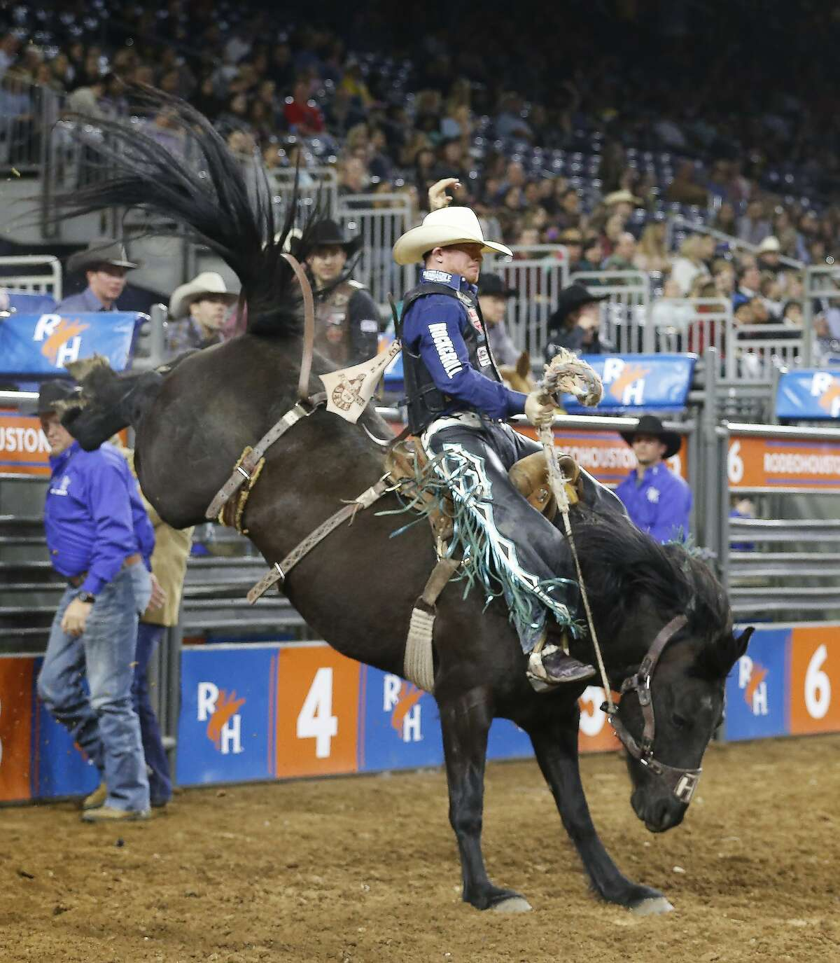 Jacobs Crawley rides Mtn Climber during Super Series III Round 3 Saddle Bronc Riding action of Rodeo Houston Wednesday, March 7, 2018, in Houston. ( Steve Gonzales / Houston Chronicle )