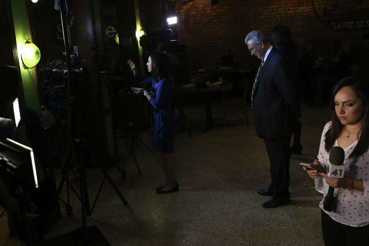 Democratic nominee for Bexar County District Attorney Joe Gonzales, center, waits for television interviews after winning the primary race against incumbent Nico LaHood, Tuesday, March 6, 2018. Gonzales will face Republican Tylden Shaeffer in the November general elections.