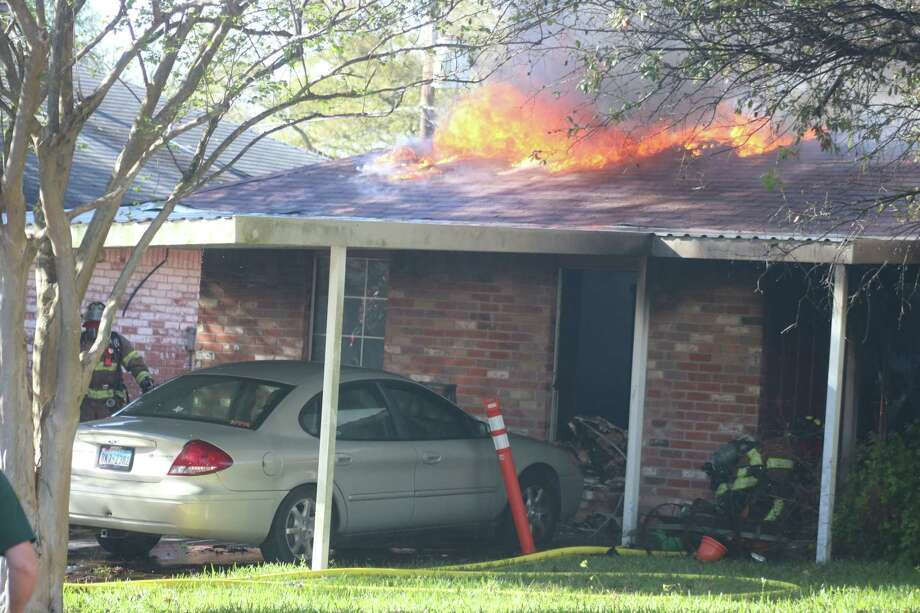 Flames come through the roof of a house on East Rutgers Street Wednesday afternoon. Photo: Robert Avery