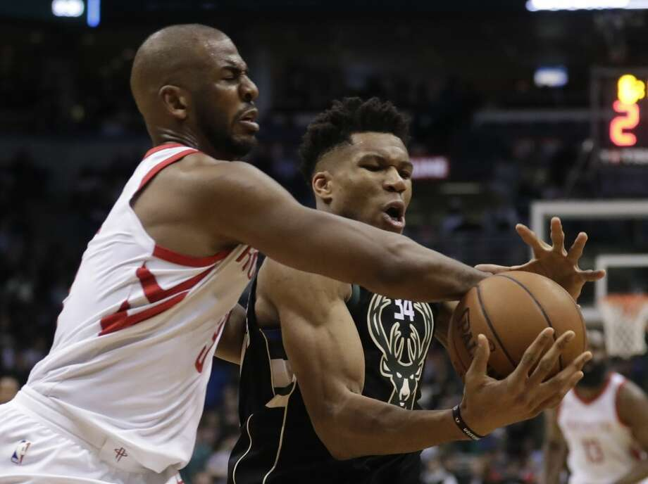Milwaukee Bucks' Giannis Antetokounmpo is fouled by Houston Rockets' Chris Paul during the second half of an NBA basketball game Wednesday, March 7, 2018, in Milwaukee. (AP Photo/Morry Gash) Photo: Morry Gash/Associated Press
