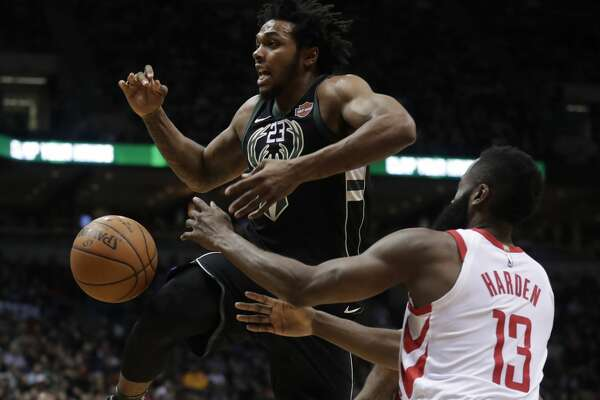 Houston Rockets' James Harden stripes the ball from Milwaukee Bucks' Sterling Brown during the second half of an NBA basketball game Wednesday, March 7, 2018, in Milwaukee. (AP Photo/Morry Gash)
