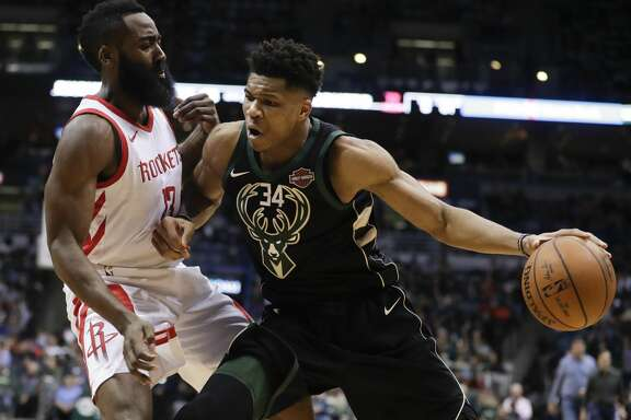 Milwaukee Bucks' Giannis Antetokounmpo tries to drive past Houston Rockets' James Harden during the second half of an NBA basketball game Wednesday, March 7, 2018, in Milwaukee. (AP Photo/Morry Gash)