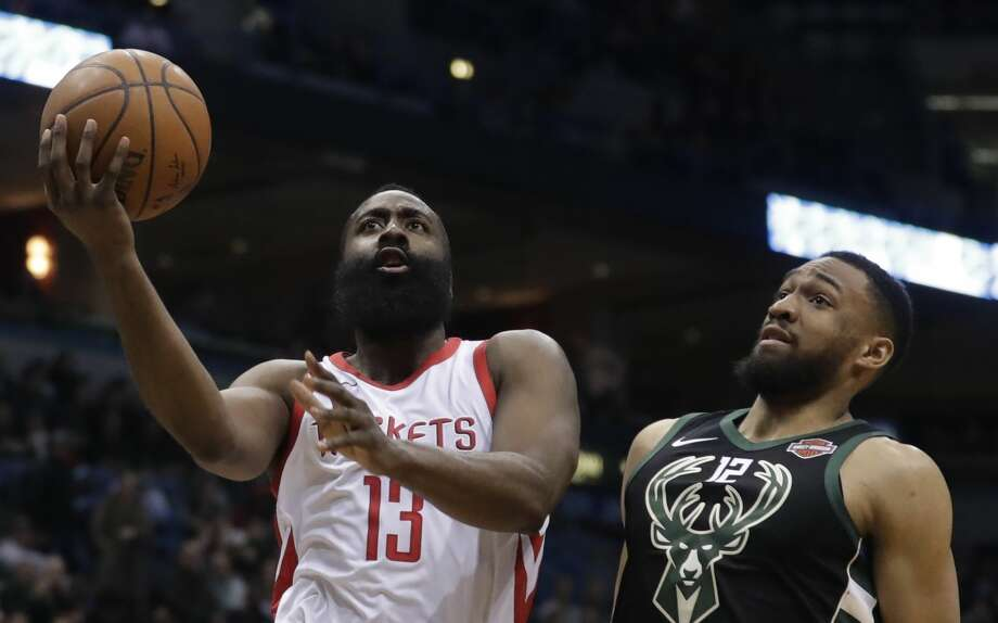 Houston Rockets' James Harden drives past Milwaukee Bucks' Jabari Parker during the first half of an NBA basketball game Wednesday, March 7, 2018, in Milwaukee. (AP Photo/Morry Gash) Photo: Morry Gash/Associated Press