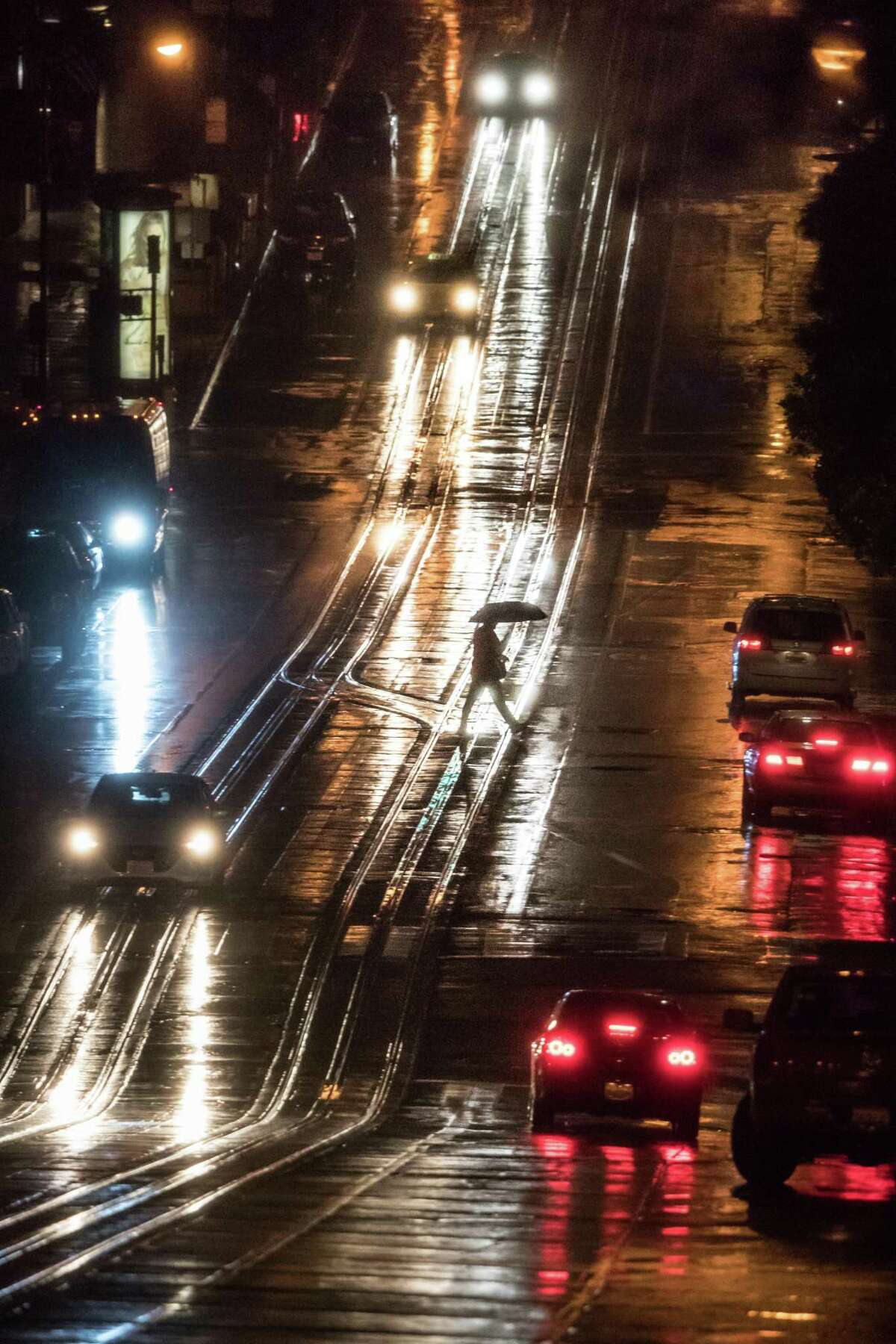 A pedestrian crosses California Street at Montgomery Street in San Francisco on Thursday, March 1, 2018