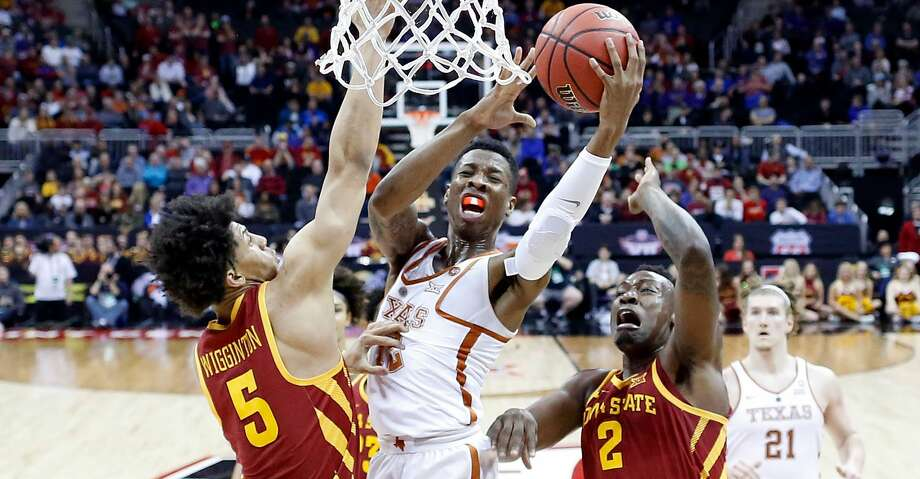 KANSAS CITY, MO - MARCH 07:  Kerwin Roach II #12 of the Texas Longhorns drives toward the basket as Lindell Wigginton #5 and Cameron Lard #2 of the Iowa State Cyclones defend during the first round of the Big 12 Basketball Tournament at the Sprint Center on March 7, 2018 in Kansas City, Missouri.  (Photo by Jamie Squire/Getty Images) Photo: Jamie Squire/Getty Images
