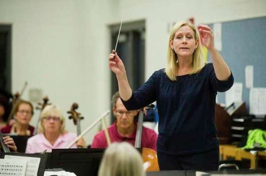 (ABOVE) Gina Provenzano conducts the Midland Community Orchestra during a 2017 rehearsal. (Daily News file photo) (BELOW) Maud Powell, circa 1919. (courtesy of www.maudpowell.org)