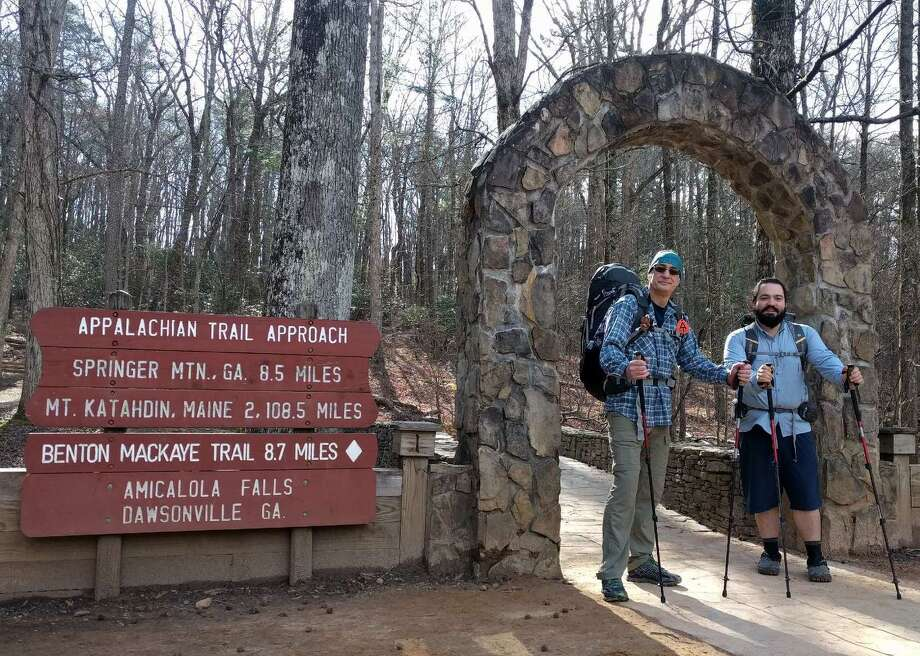 Carl Sevier (left) and Mark Maynard are ready to pass through the stone arch at Amicalola Falls, Georgia, to start their journey up the Appalachian Trail. Their final destination is Mount Katahdin, Maine, some 2,108.5 miles north. But first they'll hike more than 8 miles down the AT Approach Trail just to get to the start of the AT. Photo: Courtesy Photo