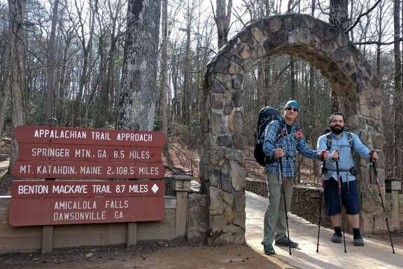 Carl Sevier (left) and Mark Maynard are ready to pass through the stone arch at Amicalola Falls, Georgia, to start their journey up the Appalachian Trail. Their final destination is Mount Katahdin, Maine, some 2,108.5 miles north. But first they'll hike more than 8 miles down the AT Approach Trail just to get to the start of the AT.