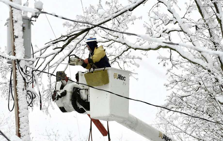 A National Grid lineman trims snow-laden branches from power lines on March 8, 2018, in Troy, NY, after the second storm in a week hits the Capital Region. Another storm Monday, March 12 into Tuesday, March 13 could make 2018 one of the snowiest Marches on record in the Capital Region. (Skip Dickstein/Times Union) Photo: Skip Dickstein/Times Union