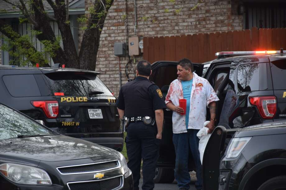 One person was hospitalized and another suffered severe injuries to his face Thursday, March 8, 2018 in a violent family fight at a house near Prescott Drive and Longmont Street in San Antonio. Photo: Caleb Downs / San Antonio Express-News