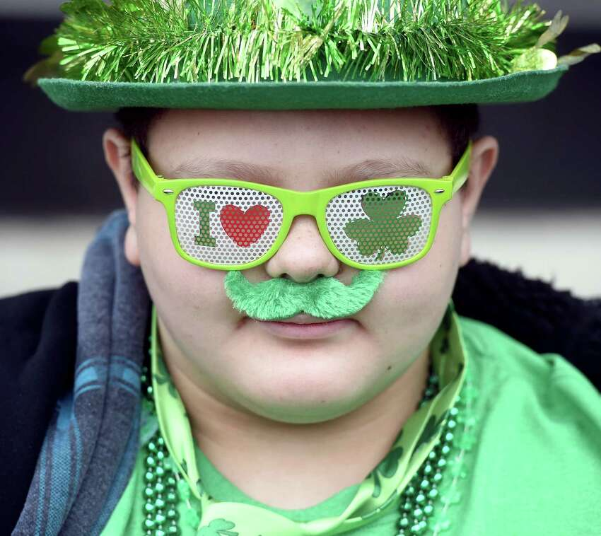 Luis Roman, 11, of New Haven watches the annual Greater New Haven St. Patrick's Day Parade on Chapel St. in New Haven in 2016.