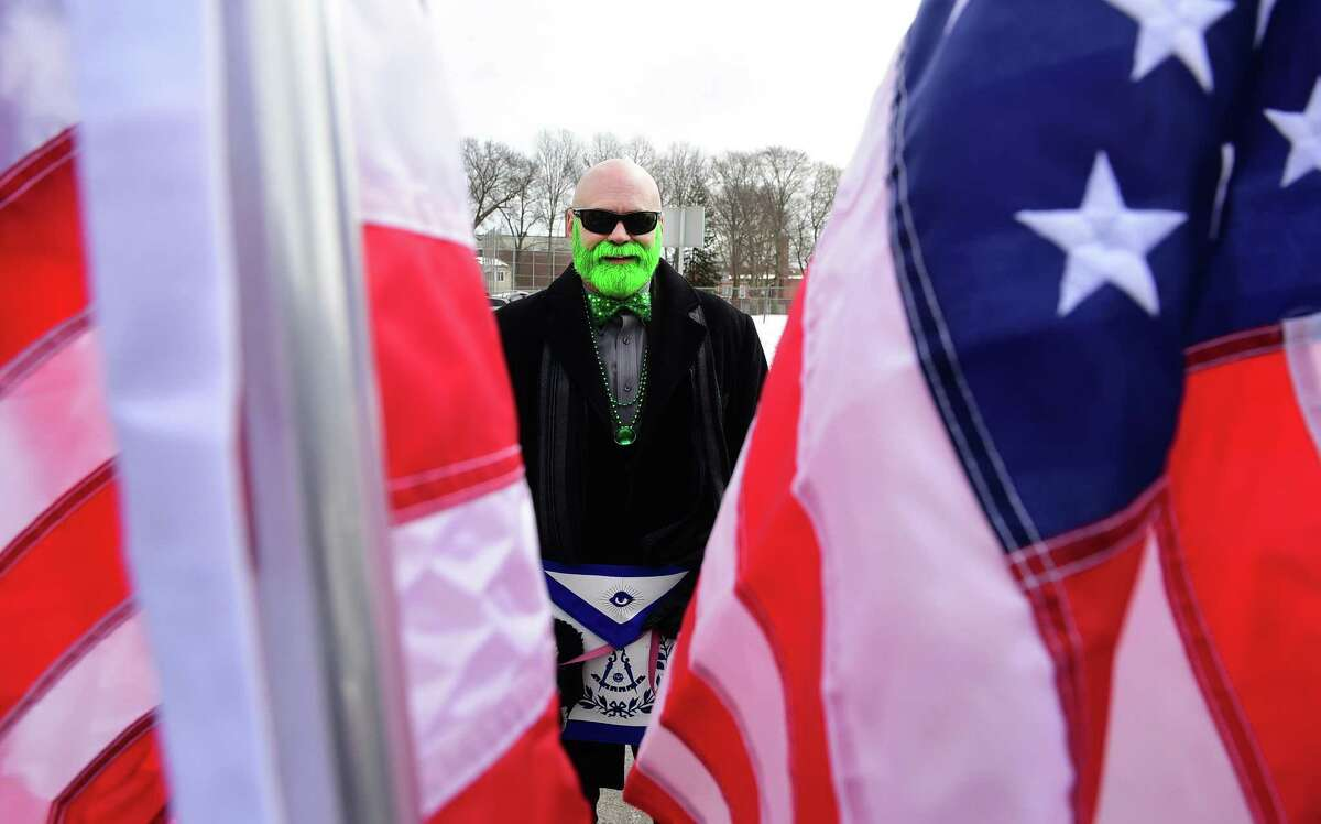 John Hanson, of Milford, waits to march in the Milford St. Patrick's Day Parade with Milford's Masonic Ansantawae Lodge 89 in 2017.