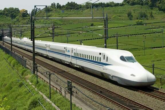 The planned high-speed rail line between Houston and Dallas would use overhead electrical lines and its own separated tracks to shuttle riders between the two metro areas, through mostly flat, rural land. The N700 train is shown in this photo illustration from Texas Central Railway, using images provided by Japan Railway Central.