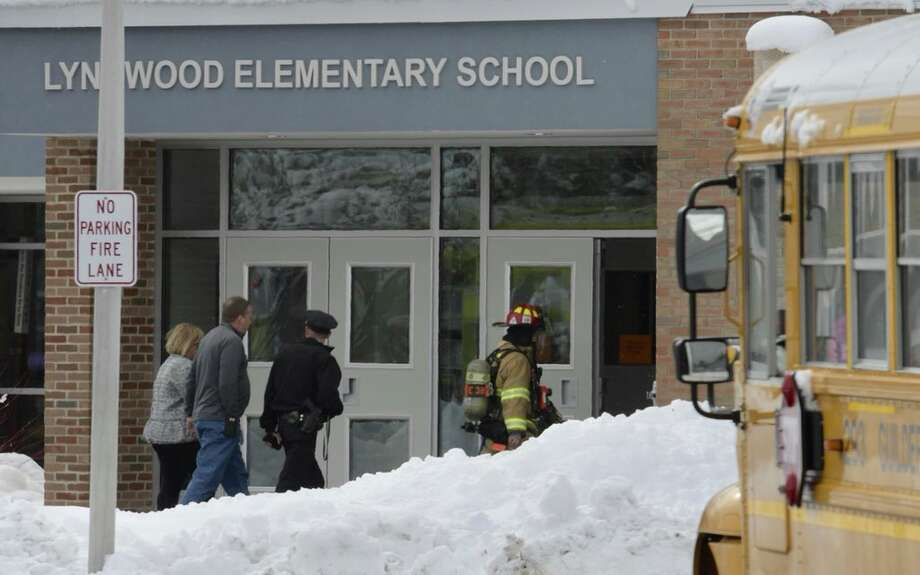 Firefighters descended on Lynnwood Elementary School in Guilderland Thursday after a fire in the boiler room. Photo: Skip Dickstein / Times Union