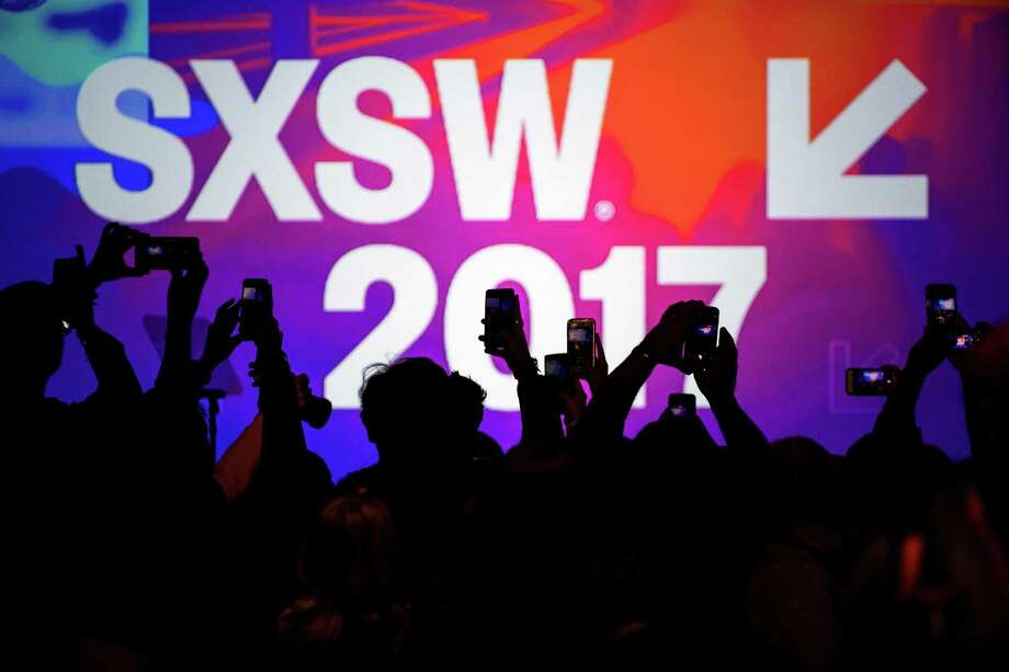 Attendees use hand held phones to take photographs at the 2017 South By Southwest Interactive Festival at the Austin Convention Center in Austin, Texas, on March 12, 2017. Photo: David Paul Morris/Bloomberg / Bloomberg