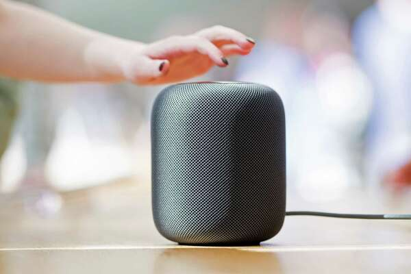 An Apple HomePod speaker rests on display at the company's retail store in San Francisco, California, on Friday, Feb. 9, 2018 / AFP PHOTO / NOAH BERGERNOAH BERGER/AFP/Getty Images
