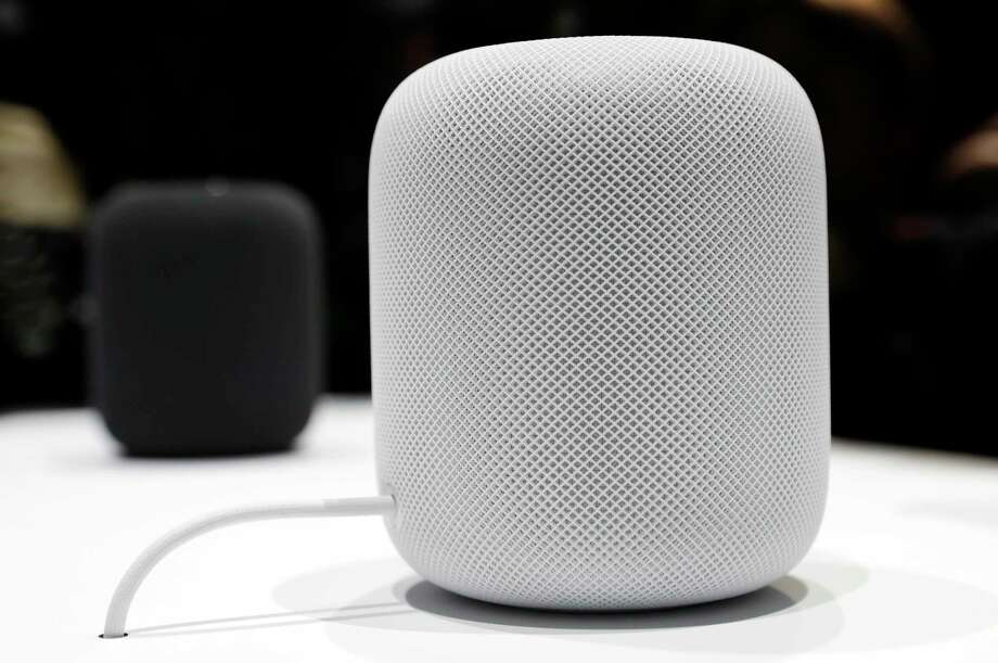 This June 5, 2017, file photo shows the HomePod speaker in a showroom during an announcement of new products at the Apple Worldwide Developers Conference in San Jose, Calif. Apple's new internet-connected speaker is proving to be more appealing to the ears than to the eyes, depending on where the device is placed. Some people who bought the just-released $349 speaker, dubbed the HomePod, are reporting that it leaves a white ring on the surfaces of wooden furniture. In an explanation posted Wednesday, Feb. 14, 2018, Apple said the problem occurs with speakers that, like the HomePod, are equipped with a silicon base to minimize vibration.  Photo: Marcio Jose Sanchez, STF / Copyright 2017 The Associated Press. All rights reserved.