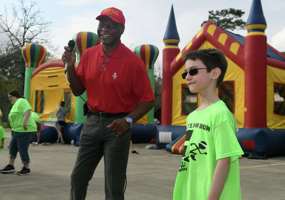 "Former Houston Rocket Calvin Murphy, left, shares a laugh with Timmy Schultz, 8, a 3rd grader at Ben Branch Elem. in New Caney, before the start of the annual ""Timmy's Adoption Fun Run"" at Kingwood United Methodist Church on March 4, 2018. (Photo by Jerry Baker/Freelance) Photo: Jerry Baker"