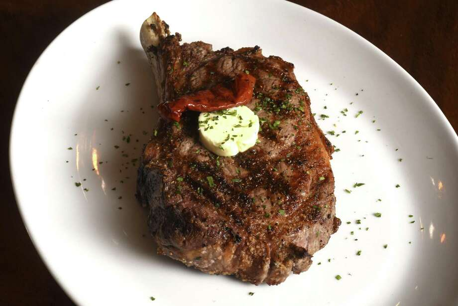 The bone-in cowboy rib-eye at Silo Prime. Photo: Billy Calzada /San Antonio Express-News / San Antonio Express-News