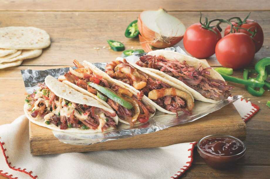 Four varieties of loaded brisket tacos are on the new Taco Cabana menu: tacos stuffed with queso and roasted jalapeños, grilled peppers and onions, fried jalapeños and onion strips with barbecue sauce and brisket only. The tacos are sold two for $5.89 or $2.99 each. Photo: Courtesy Photo