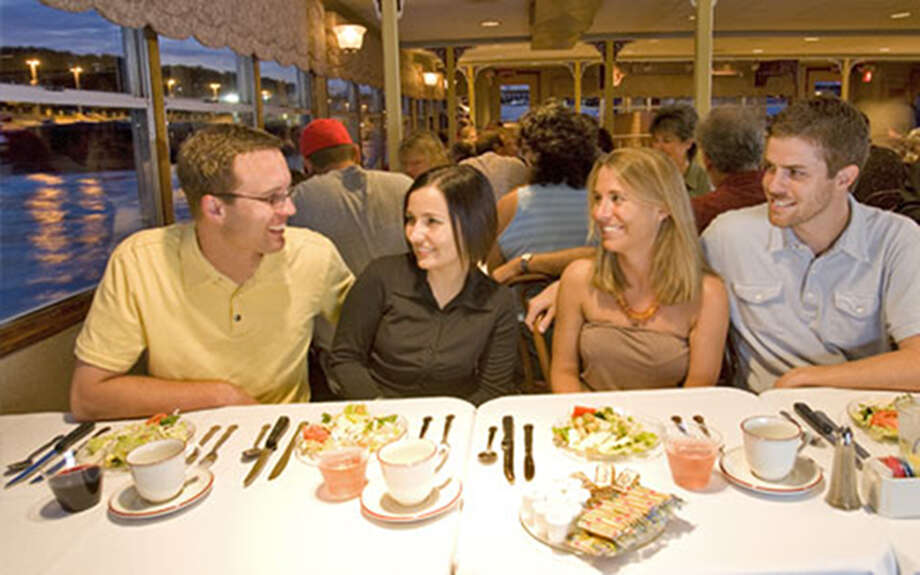 Couples enjoy one of the Skyline Dinner Cruises offered this year beginning in April. Photo: For The Edge