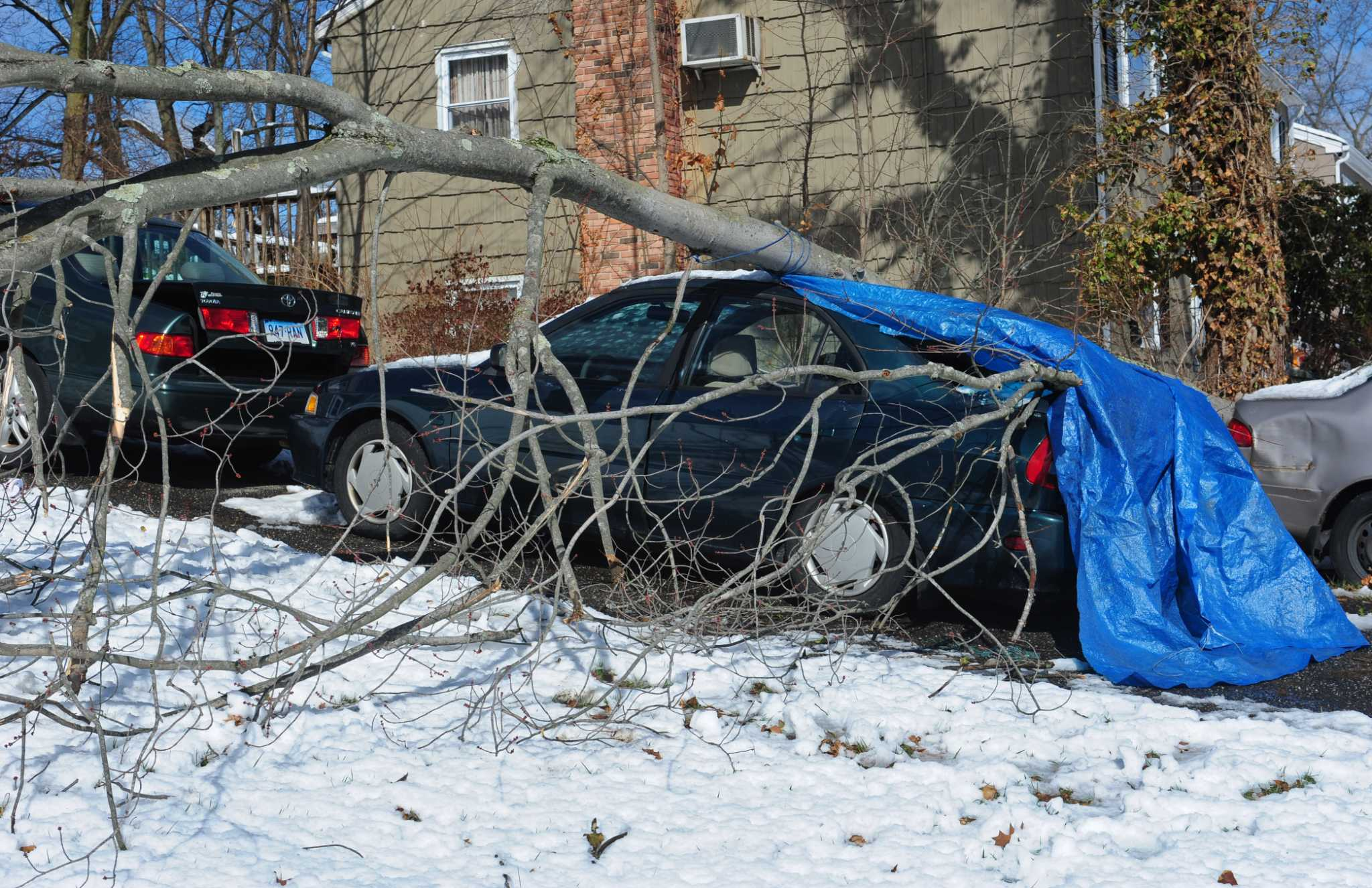 Thousands without power, dozens of roads closed after storm ...