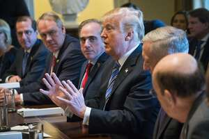 President Donald Trump speaks during a meeting with his Cabinet in the Cabinet Room at the White House, in Washington, March 8, 2018. The administration is expected to formally announce tariffs on Thursday despite pushback from Republican lawmakers and as officials began signaling carve-outs for certain countries. At Trump's immediate left is Secretary of Veterans Affairs David Shulkin. (Doug Mills/The New York Times)