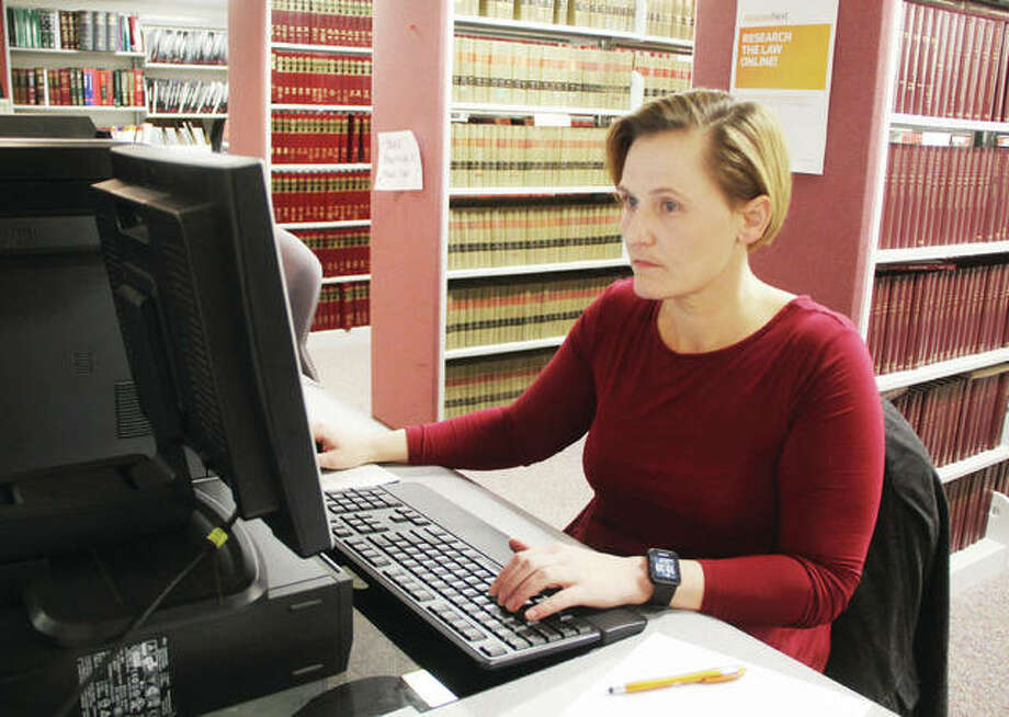 Edwardsville-based attorney Janel Freeman uses one of the computers in the Madison County Law Library to research court cases for an appeal. The library, which also serves as a self-help center for people representing themselves in the court system, offers both bound volumes and online records, and will soon be able to expand its services with the help of a grant from the state. Photo: Scott Cousins | The Telegraph