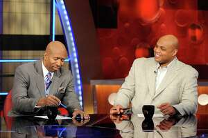 FILE - In this Feb. 4, 2010 file photo, basketball analysts Kenny Smith, left, and Charles Barkley are shown on the set at TNT studios in Atlanta. With eight years left on their deal to broadcast the NCAA Tournament, CBS and Turner are tacking on another eight. The extension announced Tuesday, April 12, 2016 goes all the way through 2032.(AP Photo/Erik S. Lesser, File)