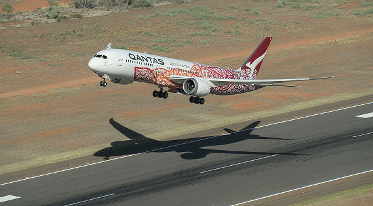 A newly painted Qantas Boeing 787 Dreamliner aircraft takes part in an air to air filming shoot on March 2, 2018 in Alice Springs, Australia. The special livery honours the work of late Northern Territory artist and Anmatyerre woman, Emily Kame Kngwarreye. It is based on her 1991 painting, Yam Dreaming, signifying the importance of the yam plant as a staple food source in her home region of Utopia, 230km north-east of Alice Springs.