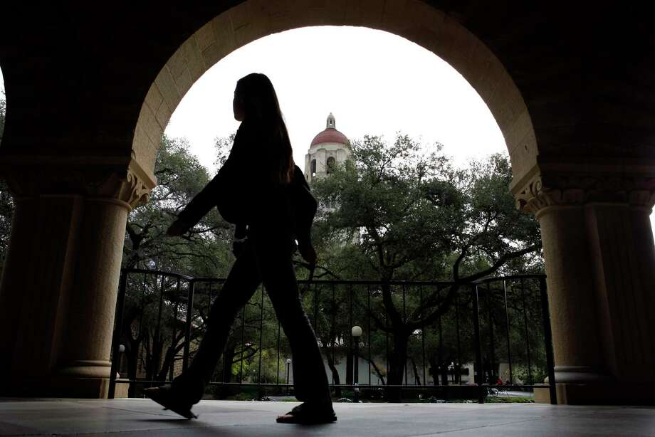 A student passes Hoover Tower in the background at the Stanford University campus in Stanford, California, in 2008. Photo: Erin Lubin/Bloomberg News / Bloomberg