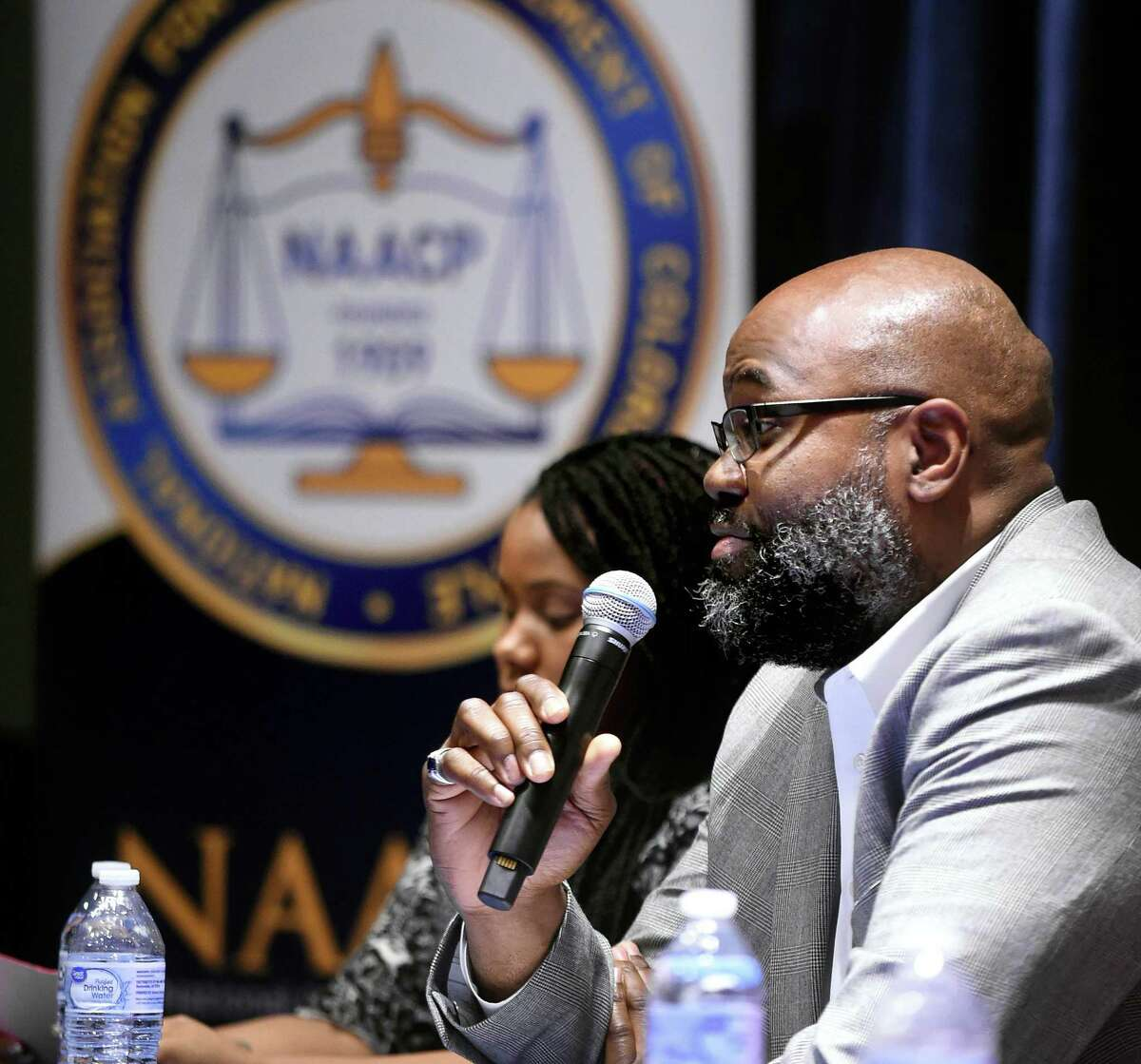 """David Canton, associate professor of history and director of Africana Studies at Connecticut College, speaks during a panel discussion at the """"Know Your Rights/Right to Protest"""" event hosted by the New Haven branch of the NAACP at Southern Connecticut State University in New Haven."""