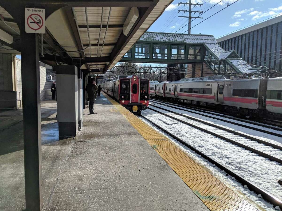 At the Greenwich Train Station the crowd has lifted and a nearly empty train picks up passengers headed to Grand Central Terminal in New York City at 9 a.m. Thursday, March 8, 2018. The trains had been combined earlier that morning at New Haven, causing massive crowding and delays from Wedesday's storm 2.0.