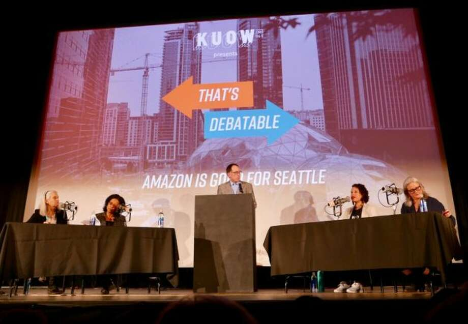"KUOW ""That's Debatable"" participants, from left, Maud Daudon, Marilyn Strickland, moderator Ross Reynolds, Nikkita Oliver and Cary Moon on stage at the SIFF Egyptian Theater in Seattle on Wednesday night. Photo: Kurt Schlosser/GeekWire"