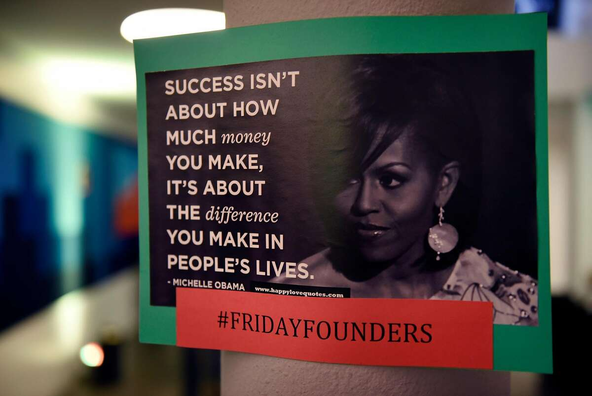A Michelle Obama quote is posted on the wall during a monthly First Friday mixer for Oakland tech entrepreneurs held at the Kapor Center for Social Impact in Oakland, Calif., on Friday February 2, 2018.