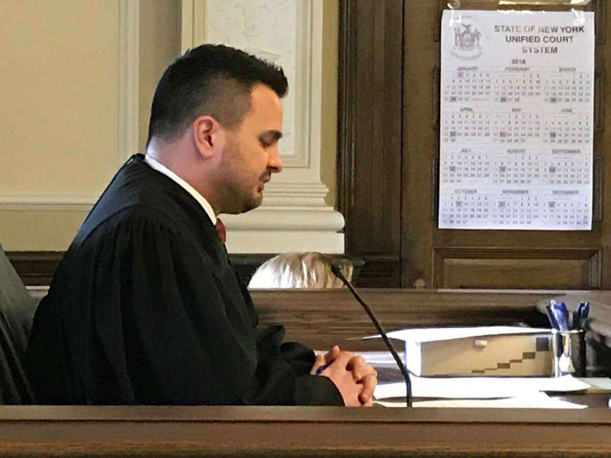 State Supreme Court Justice Andrew Ceresia prepares to resentencing Johnny Oquendo for the 2015 killing of Oquendo's stepdaughter. The judge ruled Oquendo should be resentenced after the probation report included information about a crime Oquendo committed as a juvenile offender in their pre-sentencing report.