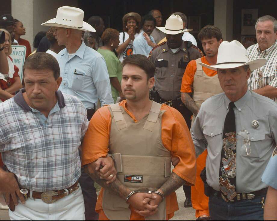 John William King, front, and Lawrence Russell Brewer are escorted from the Jasper County Jail Tuesday, June 9, 1998, in Jasper, Texas. King, Brewer and Shawn Allen Berry are charged with first degree murder in the death of James Byrd Jr. Byrd Jr. was tied to a truck and dragged to his death along a rural East Texas road. (AP Photo/David J. Phillip) Photo: DAVID J. PHILLIP / AP
