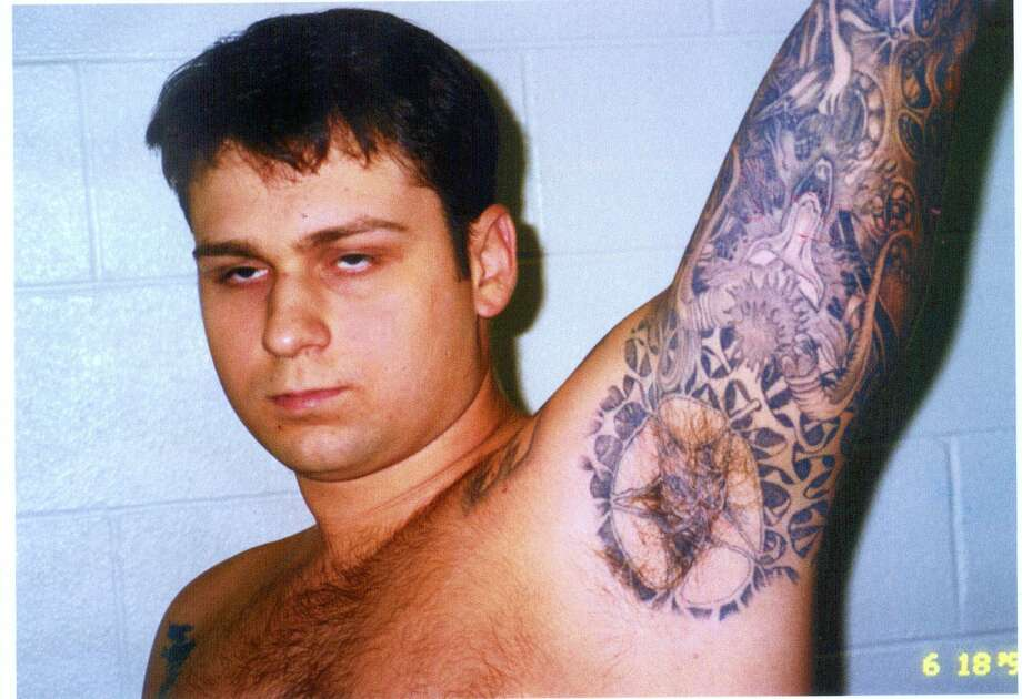 FILE - This photo of murder defendant John William King, showing some of his tattoos, was entered into evidence Wednesday, Feb. 17, 1999, in Jasper, Texas. King is one of three white men charged with capital murder in the dragging death of James Byrd Jr. (AP Photo/Jasper County District Attorney's Office, POOL) Photo: HO / JASPER COUNTY DISTRICT ATTORNEY