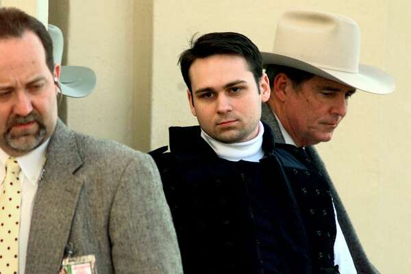 Convicted killer John William King, center, is escorted from the Jasper County Courthouse after being found guilty of capital murder in the dragging death of James Byrd Jr. Tuesday, Feb. 23, 1999, in Jasper, Texas. King is asking the state to drop the automatic appeal of his death sentence and also wants to withdraw his response to a wrongful death lawsuit filed by the children of James Byrd Jr. (AP Photo/David J. Phillip)