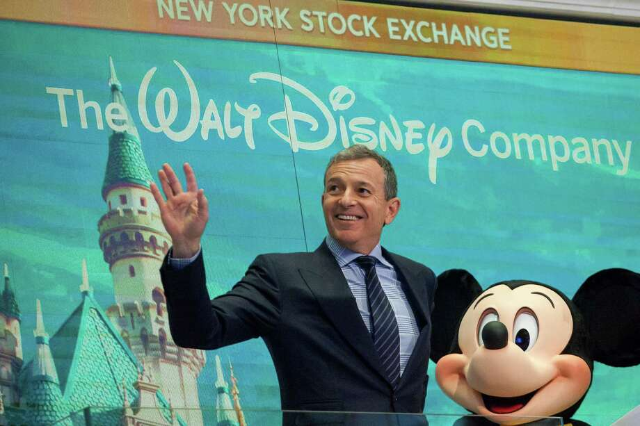 Bob Iger, chairman and chief executive officer of The Walt Disney Co., joins mascot Mickey Mouse to ring the opening bell on the floor of the New York Stock Exchange in New York on Nov. 27, 2017. Photo: Michael Nagle/Bloomberg / Bloomberg