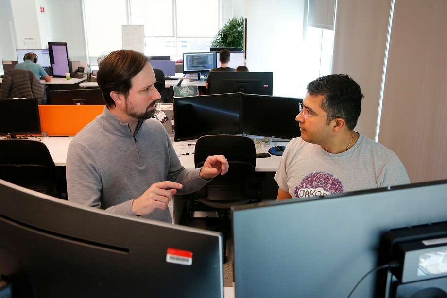 Anson Mayers, senior software engineer, (left) and Abhijeet Khatri, software engineer, at the offices of ServiceNow in San Francisco. ServiceNow, a cloud computing company headquartered in Santa Clara, opened up an office in San Francisco a few years ago. Photo: Michael Macor, The Chronicle
