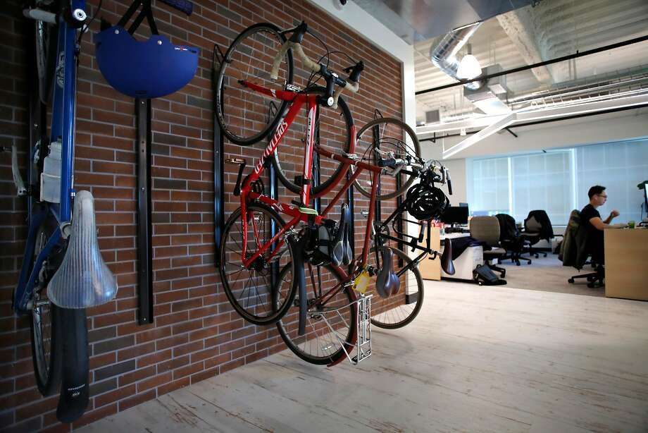 Several employees ride their bicycles to work and store them inside the San Francisco offices of ServiceNow. Sean Convery, a vice president, said opening an additional office in the city was critical for hiring the people he needs. Photo: Michael Macor, The Chronicle