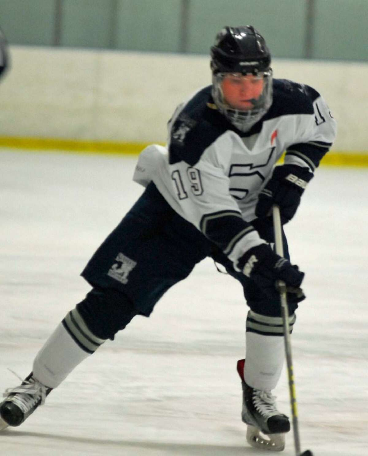 Division III skater of the year Sam New looks to lead top-seeded Staples over Newington in the quarterfinals.