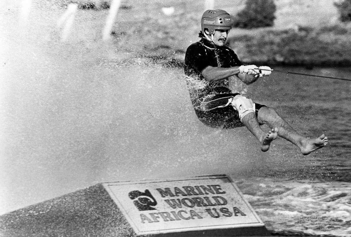 A barefoot water skier takes a jump at Marine World. circa Sept. 11, 1983.