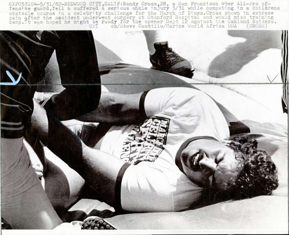 49ers guard Randy Cross injured his ankle in Whale of a Time World at Marine World Africa U.S.A.on June 1, 1982. Photo: UPI