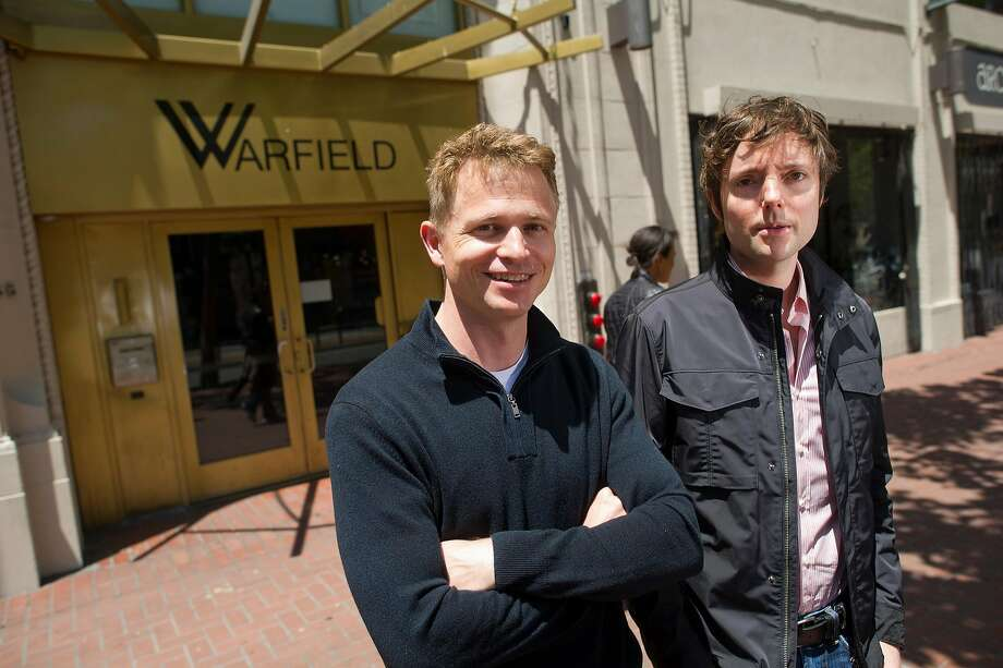 Peter Fenton, left and Matt Cohler, general partners of Benchmark Capital, stand in front of the Warfield building in San Francisco. Benchmark opened an office on Market Street in 2012, close to several companies the firm has backed, including Uber and Twitter. Photo: David Paul Morris, Bloomberg