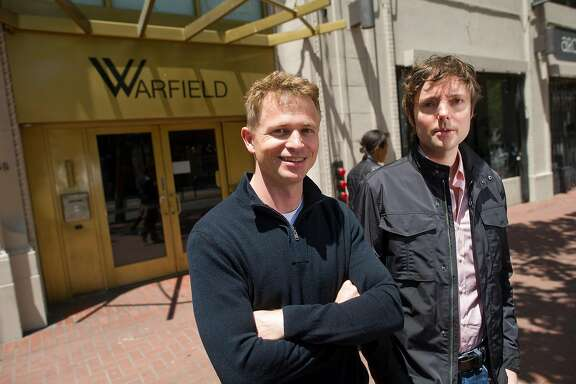Peter Fenton, left and Matt Cohler, both general partners of Benchmark Capital, stand for a photograph in front of the Warfield building in San Francisco, California, U.S., on Thursday, May 24, 2012. Photographer: David Paul Morris/Bloomberg *** Local Caption *** Peter Fenton;Matt Cohler