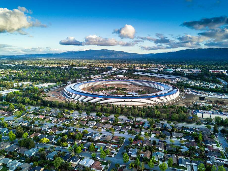"""An aerial photo of Apple's new Cupertino campus, with its centerpiece building widely known as the """"spaceship."""" Much has changed in recent decades, but the new headquarters still falls within the traditional geographical definition of Silicon Valley. Photo: SpVVK, Getty Images"""
